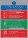 <p>Fire Action Sign with exclamation and prohibited symbols</p> Text: Fire action ON DISCOVERING A FIRE 1. Operate nearest fire alarm call point. Dial to call the fire brigade. 2. If possible tackle the fire using the appliances provided. (Do not endanger yourself or others in doing so). ON HEARING THE FIRE ALARM 3. Leave the building by the nearest available exit route closing all doors behind you. 4. Report to person in charge of assembly point at:- 5. Do not take risks. Do not stop to collect personal belongings. Do not re-enter the building for any reason unless authorised to do so.