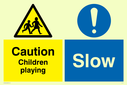 dual sign exclamation in circle & children warning symbol Text: Caution  Children playing Slow