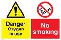 dual-sign-with-general-warning-and-no-smoking-prohibition-symbol~
