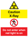 <p>Caution X-Ray. Do not enter when red light is on</p> Text: