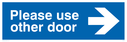 <p>Please use other door with arrow pointing right</p> Text: Please use other door (arrow right)