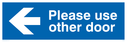 please-use-other-door-arrow-left-sign-~