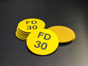 <p>Pack of 10 durable engraved Fire Door Rating FD30 signs with black text on yellow. Comes with self adhesive for safe application to fire doors.</p> Text: Fire Door Rating 30 minutes FD30 yellow black laminate self adhesive