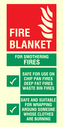 <p>Fire blanket instructions</p> Text: Fire blanket sign for mothering fires safety for use on chip pan fires, deep fat fires, waste bin fires. Safe and suitable for wrapping around someone whose clothes are burning.