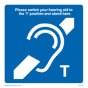 Blue background with white ear and diagonal bar and instructions, induction loop symbol. Text: Induction loop / Hearing Aid symbol with instructions