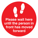 <p>Please wait here until the person in front has moved forward</p> Text: