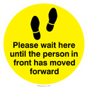 <p>Please wait here until the person in front has moved forward - yellow</p> Text: