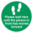 <p>Please wait here until the person in front has moved forward - green</p> Text: