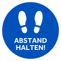 <p>Blue with white footprints and ABSTAND HALTEN! / (KEEP YOUR DISTANCE in German)</p> Text: ABSTAND HALTEN!