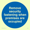 <p>remove security fastening in blue circle</p> Text: remove security fastening when premises are occupied