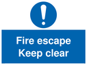 <p>Fire escape keep clear</p> Text: fire escape keep clear