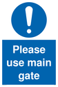 please-use-main-gate-mandatory-signwith-general-mandatory-symbol-in-blue-circle~