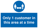 <p>Only 1 customer in this area at a time sign </p> Text: