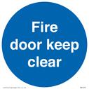 <p>Fire door keep clear</p> Text: