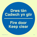 bi-lingual sign - welsh / english in blue circle Text: drws tan cadwch yn glir fire door keep clear