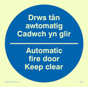 bi-lingual sign - welsh / english in blue circle Text: drws tan automatig cadwch yn glir / automatic fire door keep clear