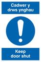bi-lingual sign - welsh / english with exclamation symbol Text: cadwer y drws ynghau / keep door shut