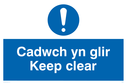bi-lingual sign - welsh / english with exclamation symbol Text: cadwch yn glir / keep clear