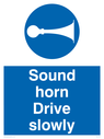 Sound horn Drive slowly, warehousing and delivery sign.  Text: Sound horn Drive slowly