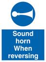 Sound horn when reversing, warehousing and delivery sign.  Text: Sound horn when reversing