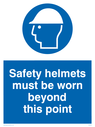 hard hat symbol Text: safety helmets must be worn beyond this point