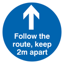 <p>Follow the route, keep 2m apart floor graphics with arrow</p> Text: Follow the route, keep 2m apart floor graphics