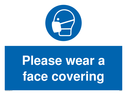 <p>Please wear a face covering</p> Text: