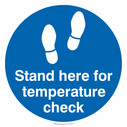 <p>Stand here for a tempreture check - floor graphic</p> Text: