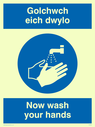 bi-lingual sign - welsh / english with hand wash symbol Text: golchwch eich dwylo / now wash your hands