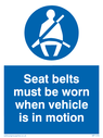 seltbelts must be worn symbol with text. Text: seltbelts must be worn when vehicle is in motion