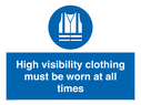 <p>High visibility clothing must be worn Mandatory Sign</p><p>with hi-vis vest required mandatory symbol in blue circle</p> Text: High visibility clothing must be worn at all times
