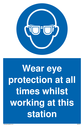 <p>eye protection required mandatory symbol in blue circle</p> Text: Wear eye protection at all times whilst working at this station