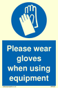 <p>Please wear gloves when using equipment mandatory protective gloves symbol</p> Text: Please wear gloves when using equipment