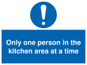 <p>Only one person in the kitchen area at a time</p> Text: