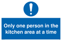 only-one-person-in-the-kitchen-area-at-a-time-sign-~