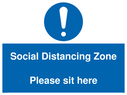 <p>Social Distancing Zone Please sit here</p> Text: