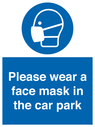 <p>Please wear a face mask in the car park</p> Text: