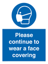 <p>Please continue to wear a face covering</p> Text: