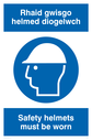 bi-lingual sign - welsh / english with hard hat symbol Text: rhaid gwisgo helmed diogelwch / safety helmets must be worn