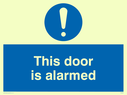 <p>this door is alarmed with exclamation in blue circle</p> Text: this door is alarmed