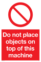 <p>Do not place objects with prohibition symbol in red circle</p> Text: Do not place objects on top of this machine