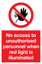 <p>no access prohibition symbol in red circle</p> Text: No access to unauthorised personnel when red light is illuminated