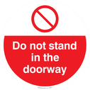 <p>Do not stand in the doorway with prohibiton symbol</p> Text: Do not stand in the doorway