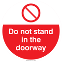 do-not-stand-in-the-doorway-with-prohibiton-symbol~