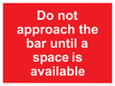 <p>Do not approach the bar until a space is available</p> Text: