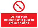 prohibited symbol Text: do not start machine until guards are in position