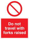general prohibition symbol Text: Do not travel with forks raised
