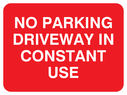 No parking sign, with white text on a red background. Text: No parking driveway in constant use