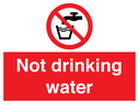 Water prohibited symbol in prohibition circle, white text on red background Text: not drinking water