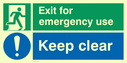 dual sign: running man facing right and exclaimation in blue circle Text: emergency exit keep clear